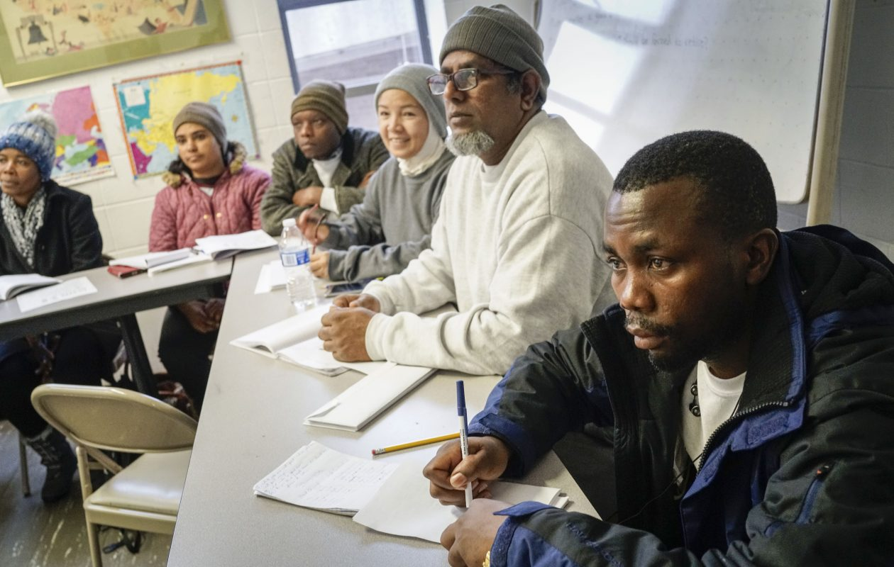 Refugees from a variety of countries take an intermediate English as a second language class at Jewish Family Services on Tuesday. With the drastic reduction in the number of refugees arriving, this class is ending and students will continue in another class at Catholic Charities. (Derek Gee/News file photo)