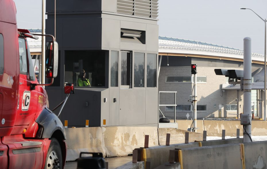 Facial recognition cameras zoom in on a trucker approaching the Peace Bridge. (Mark Mulville/Buffalo News)