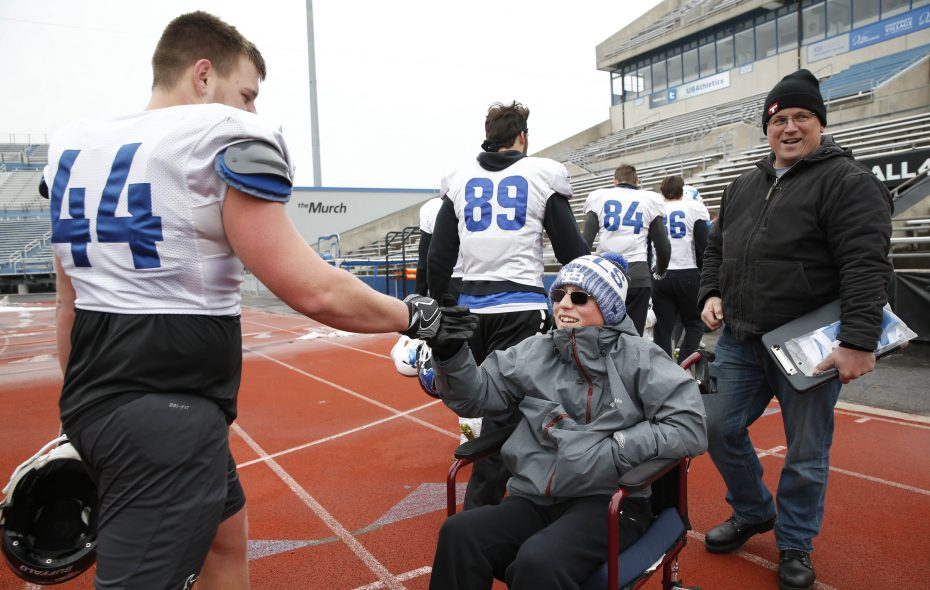 Peyton Longo, a 16-year-old with a rare form of muscular dystrophy, has been adopted by the UB football team. (Sharon Cantillon/Buffalo News)