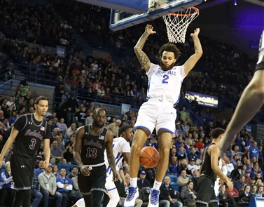 The University at Buffalo men's basketball team showed off its Top-25 form in a 73-65 win against Southern Illinois.
