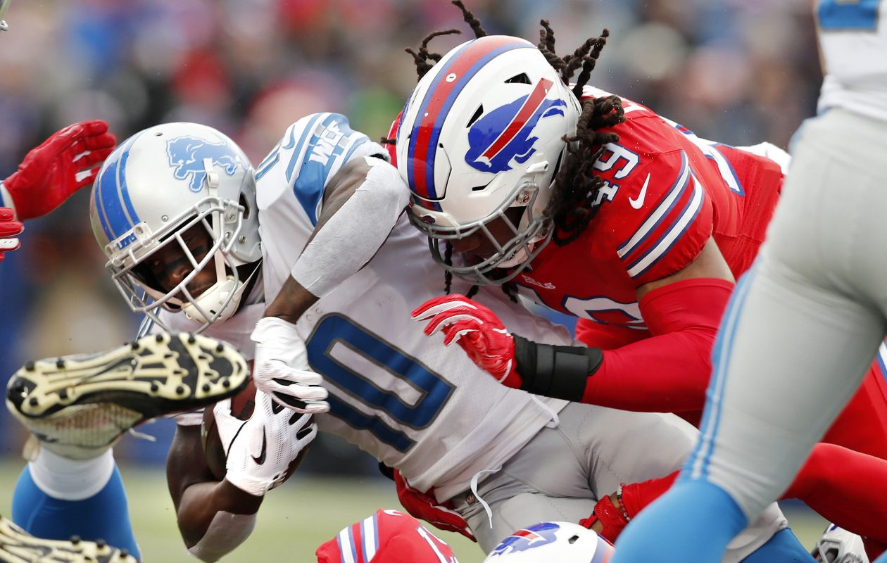 Tremaine Edmunds (right)  and Lorenzo Alexander bring down Detroit Lions' Brandon Powell. (Mark Mulville/Buffalo News)