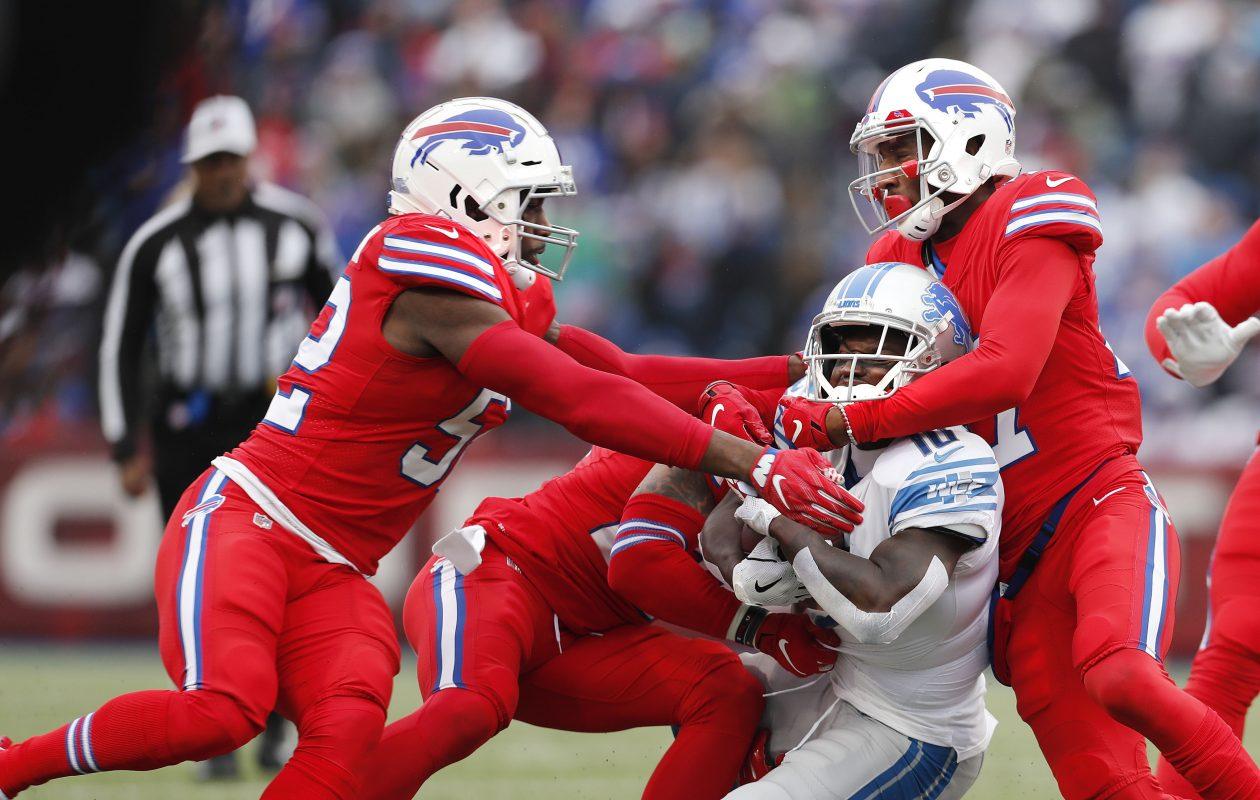 Bills defenders swarm Lions receiver Brandon Powell during Sunday's win at New Era Field. (Mark Mulville/Buffalo News)