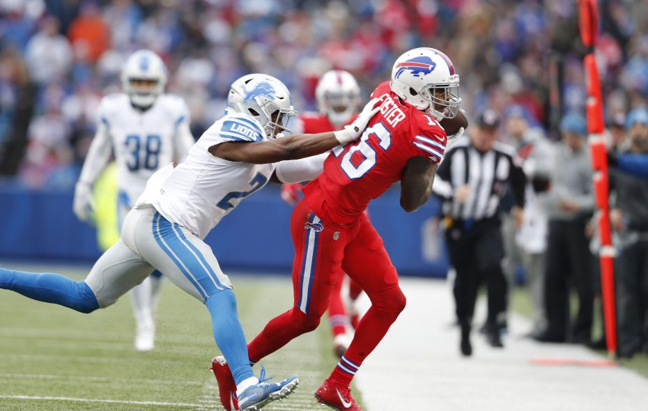 Bills' Robert Foster keeps his feet in bounds with defense by Lions' Nevin Lawson.  (Mark Mulville/Buffalo News)