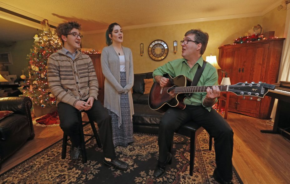 Paul Weisenburger, on guitar, rehearses with his children Stephen and Claire for their holiday performances.  (Robert Kirkham/Buffalo News)