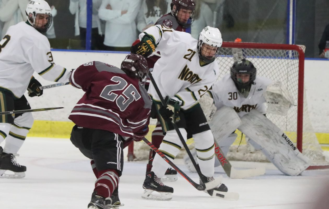 St. Joe's player Frankie Attea takes a shot on Williamsville North's Connor Schwartz in the first period at Northtown Center in Amherst on Thursday, Dec. 20, 2018.  (James P. McCoy/Buffalo News)