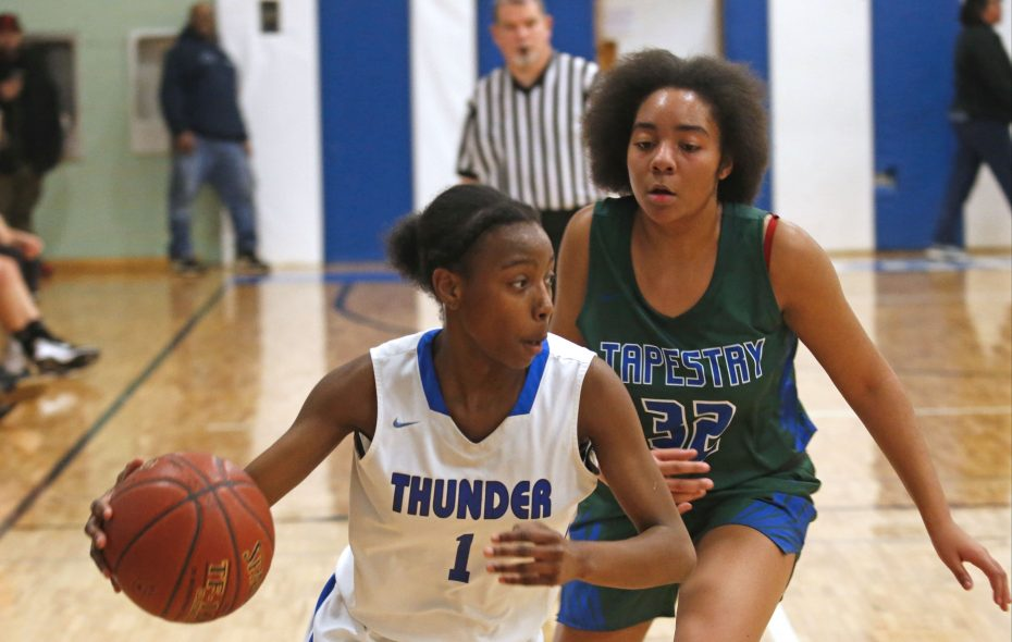 Mount St. Mary's Raven Johnson (1) drives in front of Tapestry's Vanessa Griffin (32) during a girls basketball at Mount St. Mary's in Tonawanda on Friday. Mount St. Mary's won, 74-32.   (Robert Kirkham/Buffalo News)
