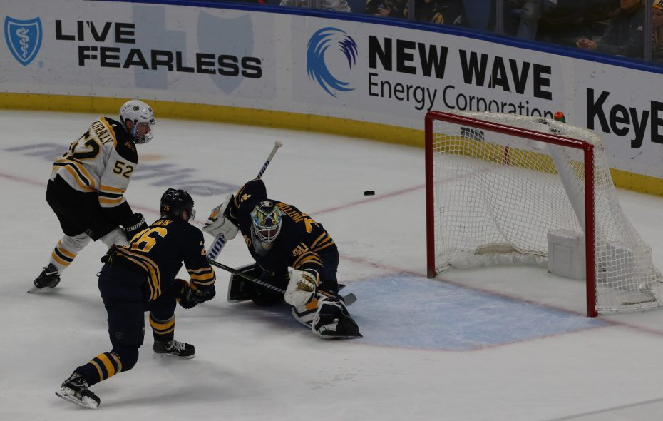 Buffalo Sabres goaltender Carter Hutton is beat on a shot by Boston's Sean Kuraly in overtime Saturday. (John Hickey/Buffalo News)