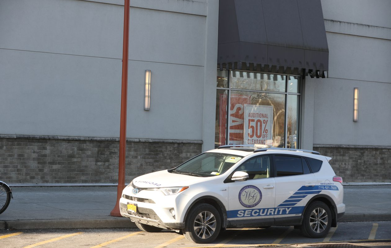 A security car is parked at the Walden Galleria, the morning after several fights broke out and caused a lockdown at the mall. (John Hickey/Buffalo News)