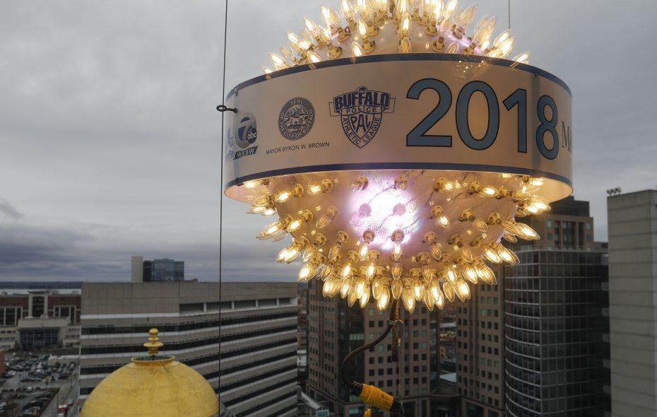 Workers test the New Years ball drop at the Iskalo Electric Tower to prepare for the annual New Year tradition on Friday. (Derek Gee/Buffalo News)