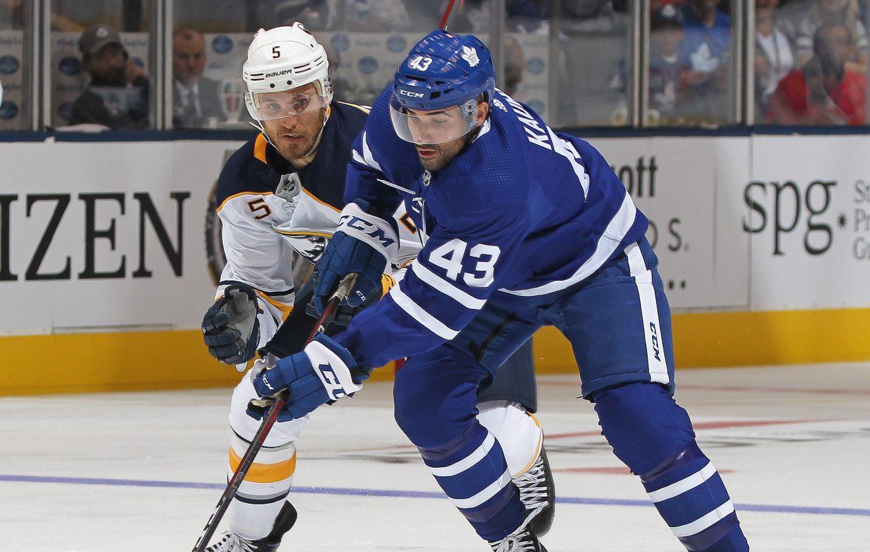 Matt Tennyson defends against Toronto's Nazem Kadri during a preseason game (Claus Andersen/Getty Images)