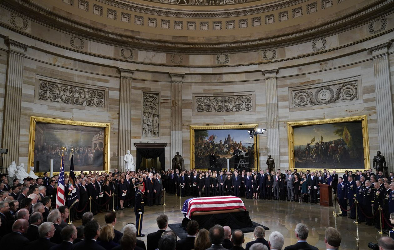 The flag-draped casket of former President George H.W. Bush lies in state in the Capitol Rotunda on Dec. 03, in Washington, DC. The 41st president and First Lady Barbara Bush both died in 2018.  (Pablo Martinez Monsivais - Pool/Getty Images)