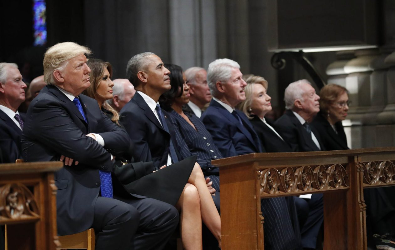 From left, President Donald Trump, first lady Melania Trump, former President Barack Obama, former first lady Michelle Obama, former President Bill Clinton, former Secretary of State Hillary Clinton, and former President Jimmy Carter and former first lady Rosalynn Carter, listen as former President George W. Bush speaks during the state funeral for former U.S. President George H. W. Bush at the Washington National Cathedral Wednesday.  (Photo by Alex Brandon - Pool/Getty Images)