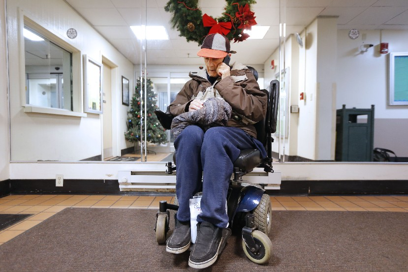 John Flickner, 78, waited in the lobby of Niagara Towers for hours on Tuesday after he was evicted from his apartment for using medical marijuana. He has a prescription for the drug. (Robert Kirkham/Buffalo News)