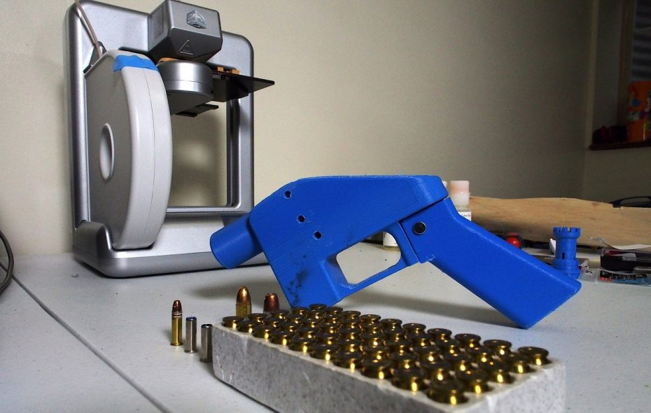 A Liberator pistol appears on July 11, 2013, next to the 3D printer on which its components were made. The single-shot handgun is the first firearm that can be made entirely with plastic components forged with a 3D printer and computer-aided design (CAD) files downloaded from the Internet. (Getty Images)
