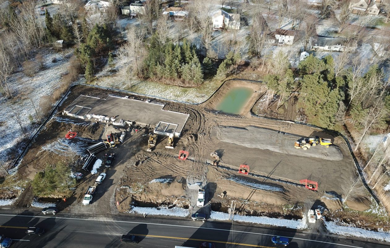 Two of three lawsuits spurred by a planned apartment complex at 4400 N. French Road in Amherst have been settled. This is an aerial view of site work that began in late September.(Photo courtesy the Green Organization)
