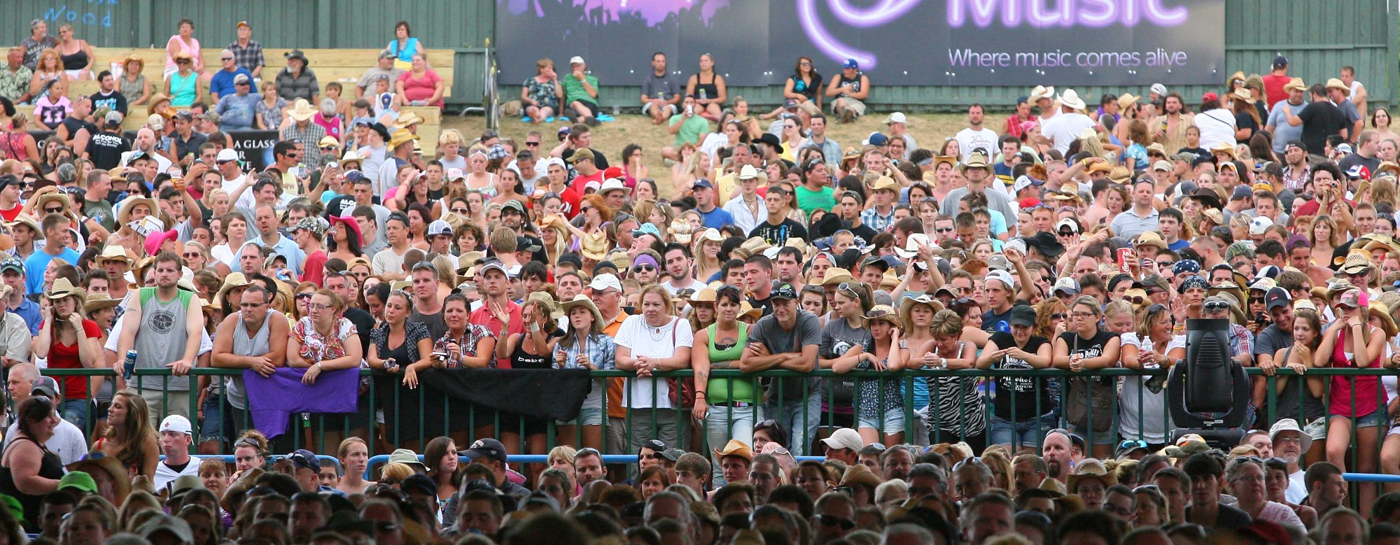 Fans standing on the Darien Lake lawn before a country show in 2011. (News file photo)