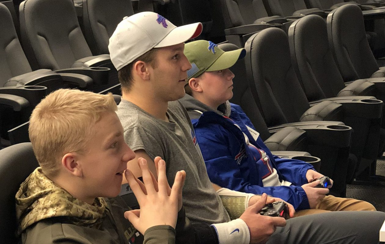 Bills quarterback Josh Allen, center, plays a video game with Jordan Peterson, right, a 16-year-old from North Dakota, who is a double lung transplant recipient and a huge Bills fan. (Photo courtesy of Dan Peterson)