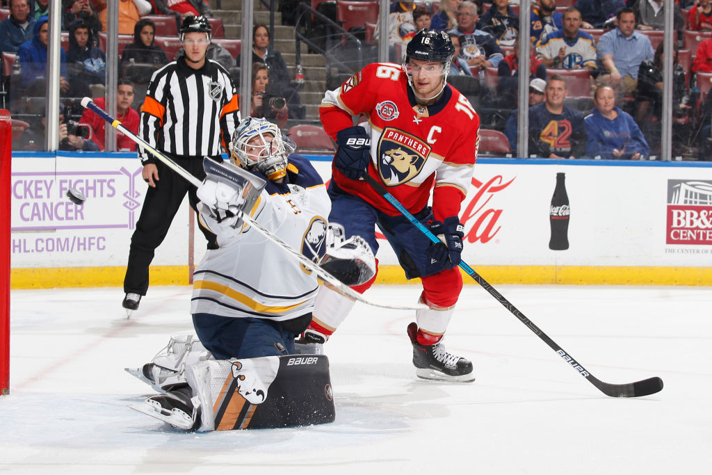 Florida captain Aleksander Barkov, who would go on to score the winning goal in overtime, works against Sabres goalie Linus Ullmark during the teams' Nov. 30 meeting in Sunrise. (Getty Images)