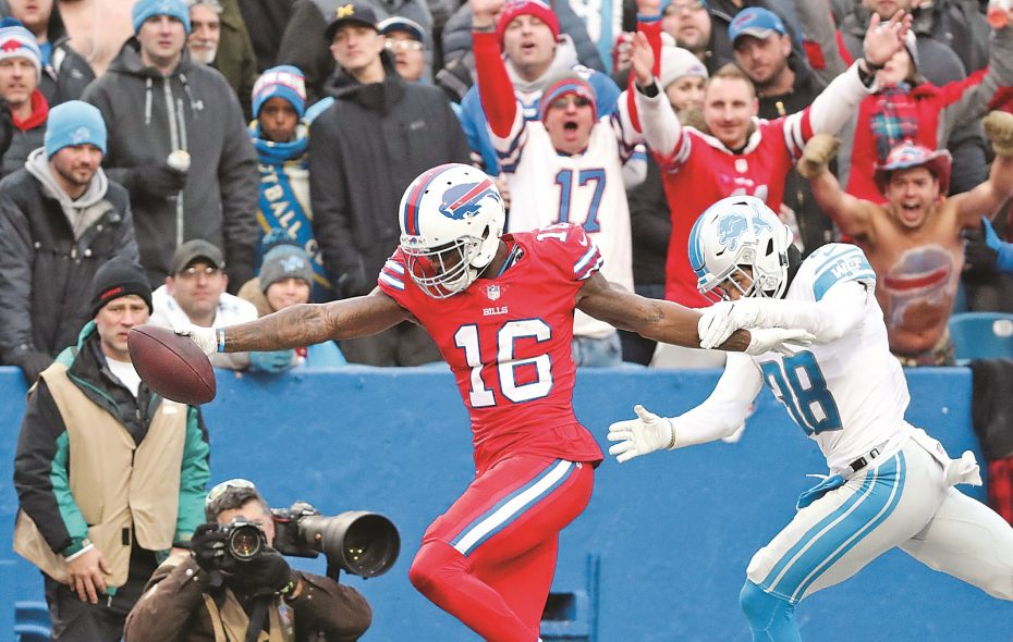 Robert Foster (16) scores the game winning touchdown in SUnday's game against against the Detroit Lions (James P. McCoy/Buffalo News
