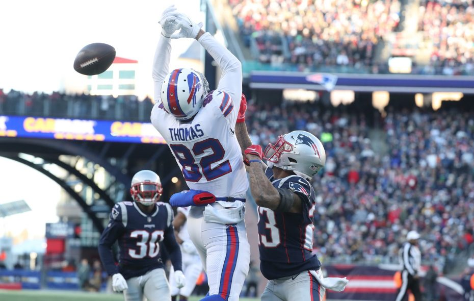 Logan Thomas drops a pass while covered by New England Patriots strong safety Patrick Chung (23) in the third quarter Sunday at Gillette Stadium in Foxborough, Mass. (James P. McCoy/Buffalo News)