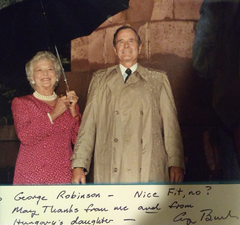 President George H.W. Bush sent this photo and note to Buffalo-born Secret Service agent George C. Robinson in 1989 after Robinson, during a rainstorm at an event in Hungary, gave the president his raincoat – only to see Bush give it to a woman in the front row later.