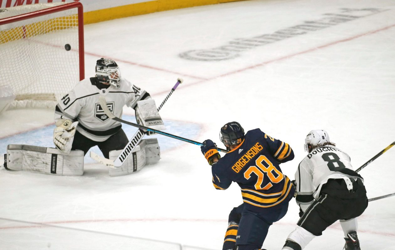 Buffalo Sabres winger Zemgus Girgensons scores on Los Angeles goalie Calvin Petersen in the first period Tuesday night. (Robert Kirkham/The Buffalo News)