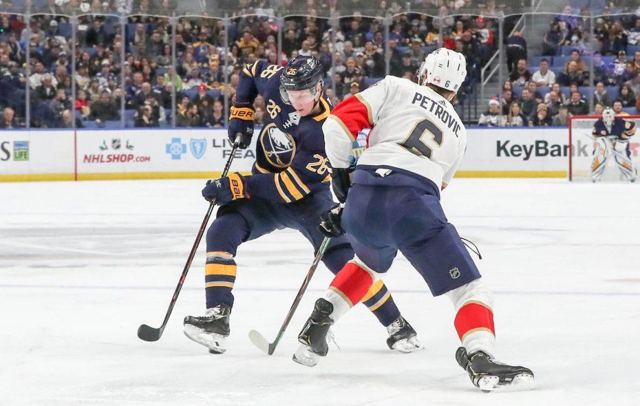 Buffalo Sabres defenseman Rasmus Dahlin attempts to skate around Florida defenseman Alexander Petrovic Tuesday night. (James P. McCoy/The Buffalo News)
