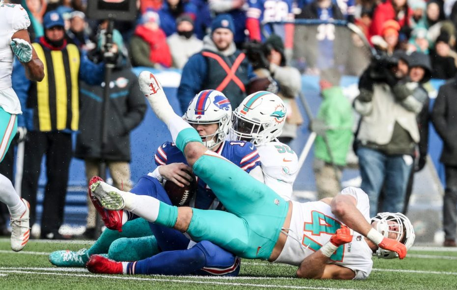 Kiko Alonso leg whips Bills quarterback Josh Allen. Alonso was ejected and a scuffle ensued (James P. McCoy / Buffalo News)