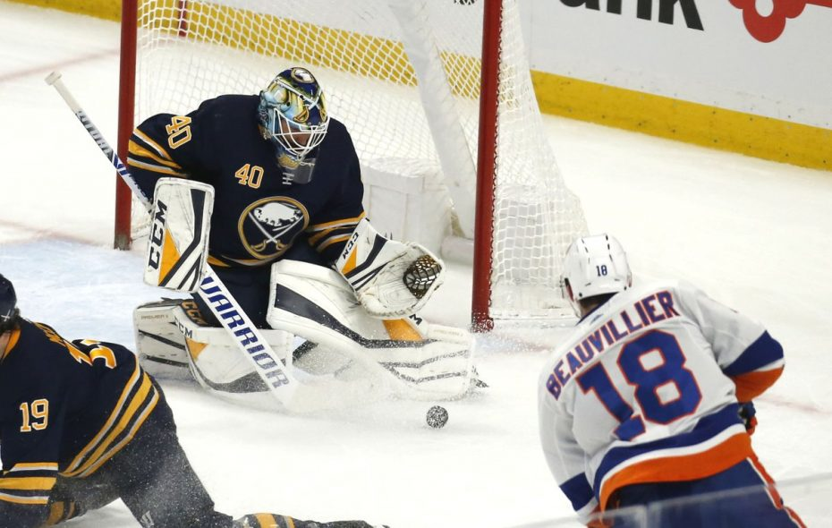 Sabres goalie Carter Hutton makes a save on Islanders winger Anthony Beauvillier during the first period Monday night in KeyBank Center. (Robert Kirkham/The Buffalo News)