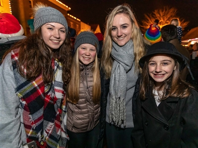 With Main Street closed between Olean and Riley, the Village of East Aurora warmly welcomed the Christmas season by singing carols on Saturday, Dec. 15, 2018, in front of Vidler's 5 and 10.