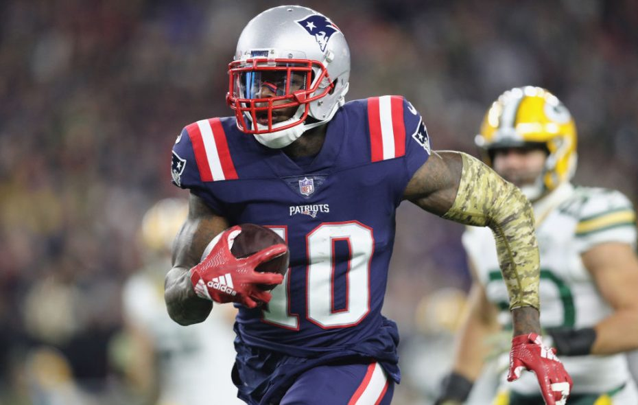 Josh Gordon #10 of the New England Patriots runs with the ball on his way to scoring a 55-yard receiving touchdown during the fourth quarter against the Green Bay Packers at Gillette Stadium on November 4, 2018 in Foxborough, Massachusetts.  (Photo by Maddie Meyer/Getty Images)