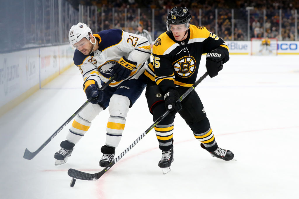 Boston's Noel Acciari battles for a puck with Buffalo's Sam Reinhart in the first period Sunday at TD Garden in Boston. (Getty Images)