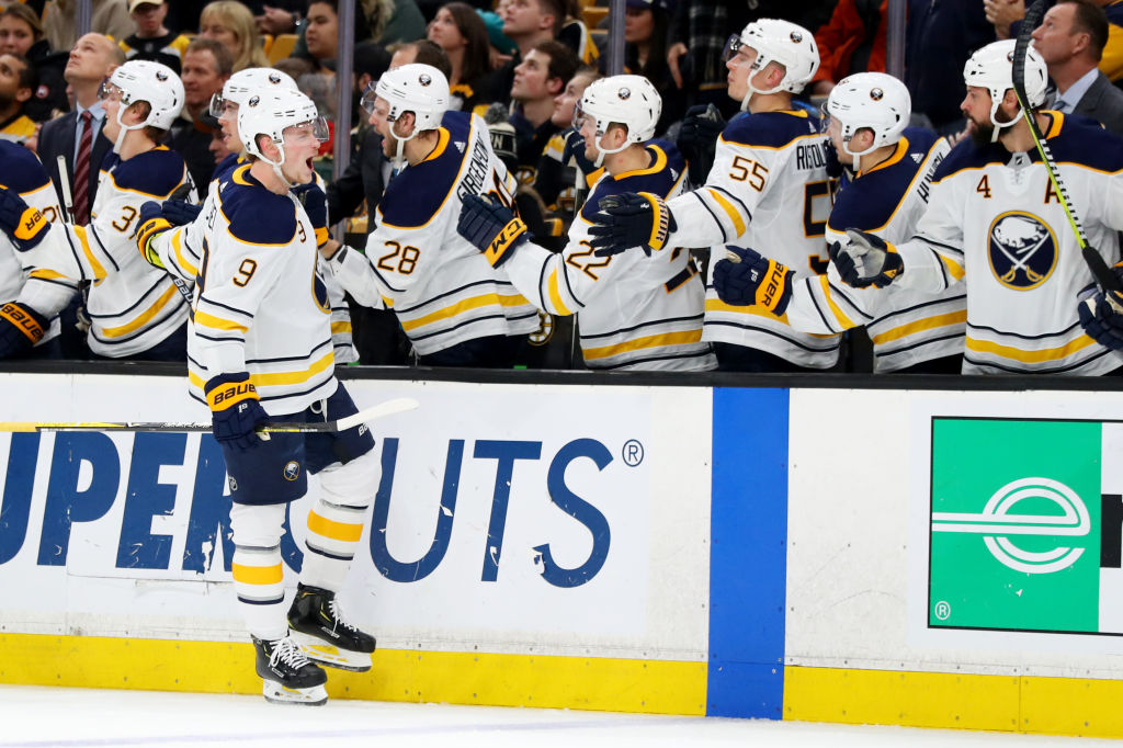 Buffalo Sabres center Jack Eichel celebrates with teammates after his go-ahead goal in the third period Sunday at TD Garden. (Getty Images)