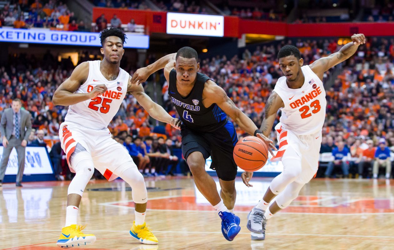 UB's Davonta Jordan drives to the basket during the first half between Syracuse's Tyus Battle and Frank Howard   (Brett Carlsen/Getty Images)