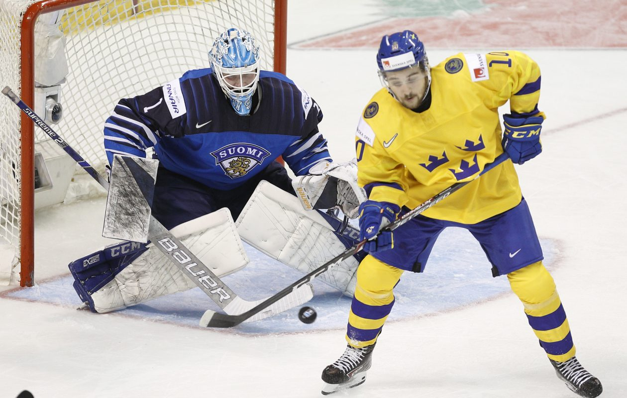Ukko-Pekka Luukkonen of Finland watches as Emil Bemstrom of Sweden attempts to tip the puck at the IIHF World Junior Championships in British Columbia. (Kevin Light/Getty Images)