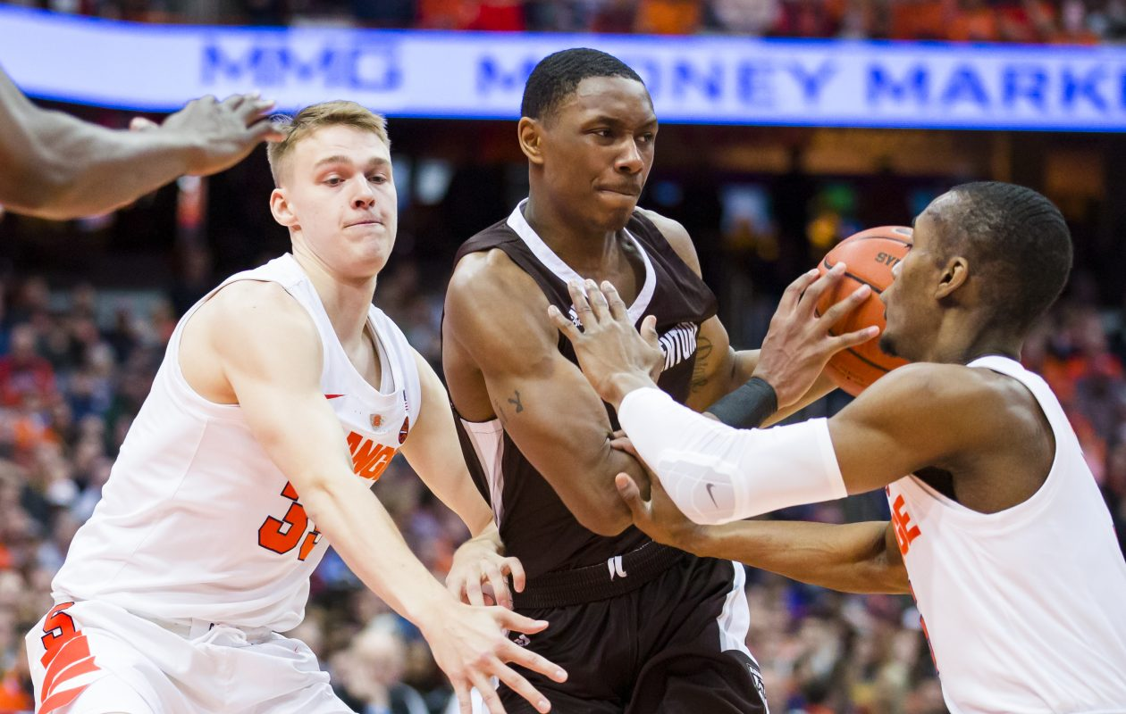 St. Bonaventure's Kyle Lofton drives to the basket against Buddy Boeheim (35) and Jalen Carey (5) of the Syracuse Orange during the first half at the Carrier Dome on Saturday, Dec. 29, 2018, in Syracuse. (Brett Carlsen/Getty Images)