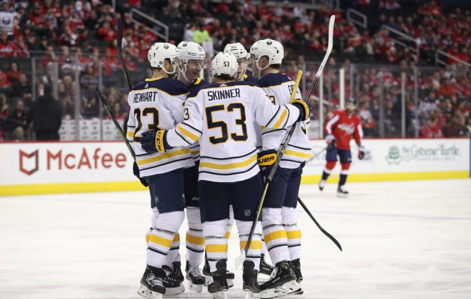 Jack Eichel celebrates with his Buffalo Sabres teammates after his first of two goals Saturday night. (Getty Images)