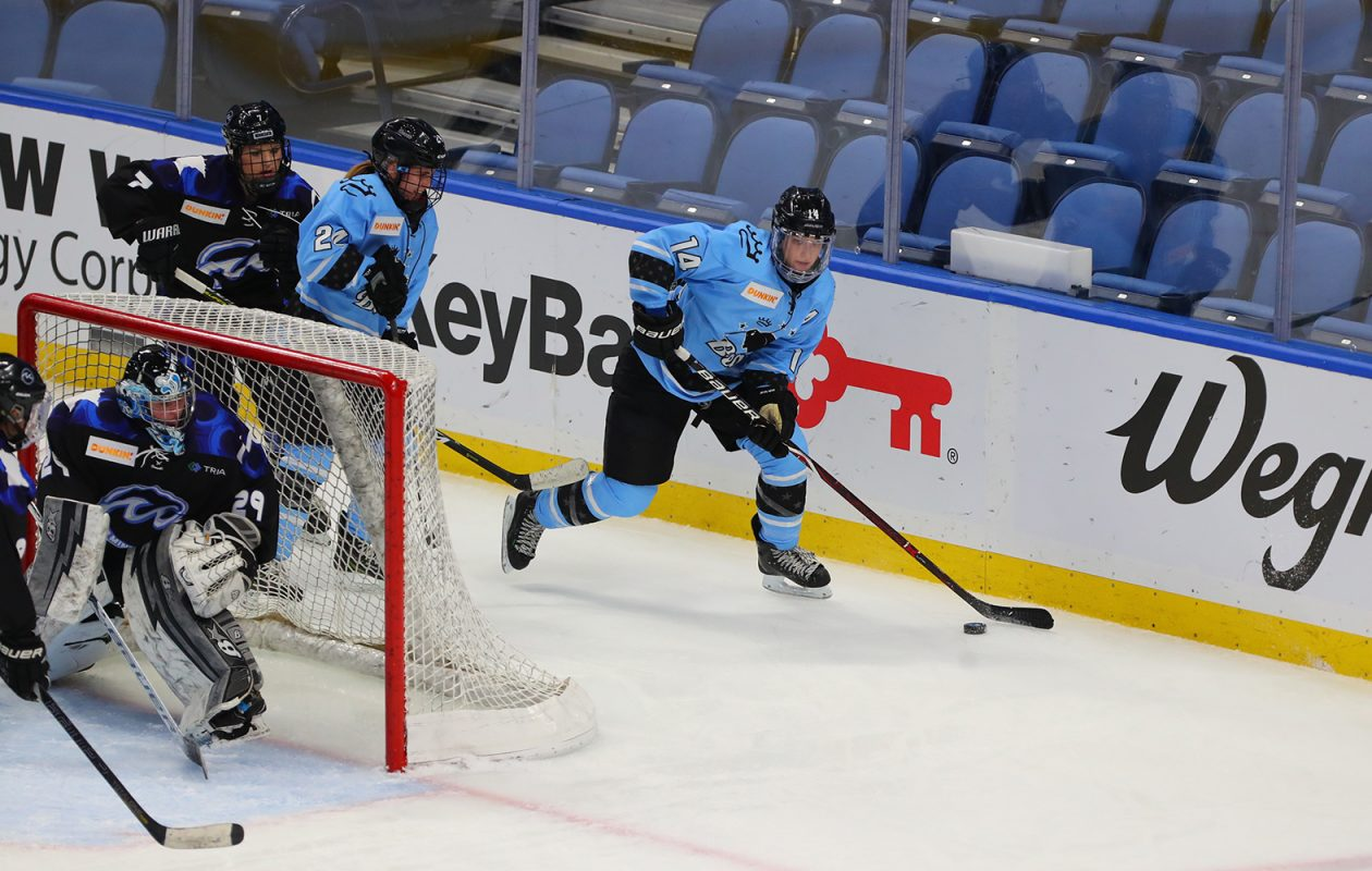 Buffalo Beauts Hayley Scamurra (14) wraps around the Minnesota Whitecaps net with Whitecaps goalie Amanda Leveille (29) in the crease during third period action Saturday at KeyBank Center.  (John Hickey/Buffalo News)