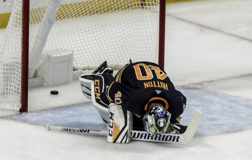 A dismayed Carter Hutton reacts after the puck rolled down his leg and into the net on Evgeni Dadonov's game-winning penalty shot Tuesday against Florida in KeyBank Center (James P. McCoy/Buffalo News).