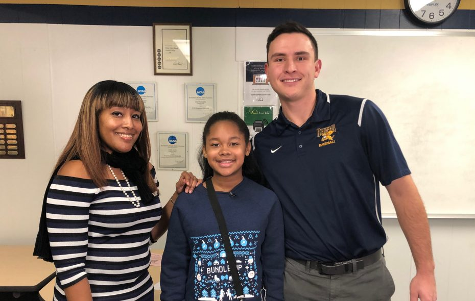Canisius College student Andrew Sipowicz, right, received a note from 11-year-old Ziarra Griffin after the school bus she was riding in damaged his car. Sipowicz, Ziarra Griffin and her mother Tocarra appeared Friday on CBS Evening News. (Provided via Andrew Sipowicz and CBS News)