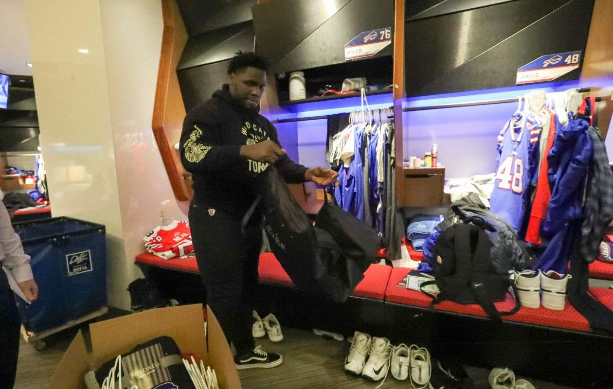 Buffalo Bills offensive guard John Miller cleans out his locker on Monday, Dec. 31, 2018. (James P. McCoy/Buffalo News)