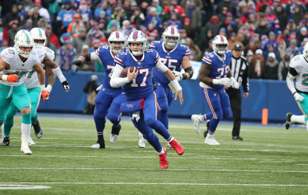 Josh Allen rushes for a first down over Miami Dolphins outside linebacker Kiko Alonso in the first quarter at Sunday's game at New Era Field. (James P. McCoy/Buffalo News)