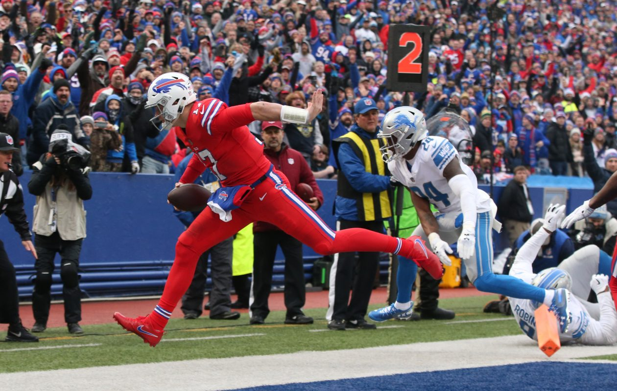 Josh Allen rushes for a touchdown against Detroit in the second quarter. (James P. McCoy/Buffalo News)