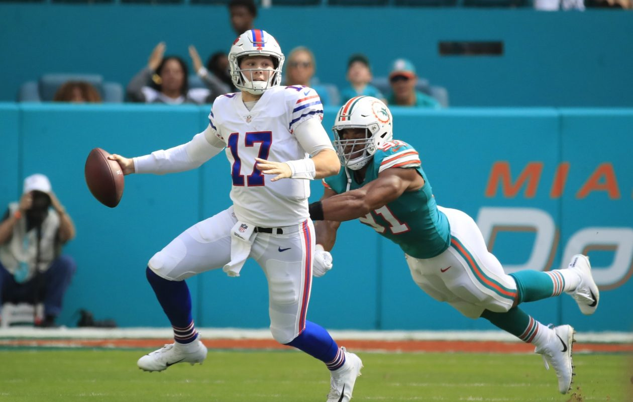 Bills quarterback Josh Allen scrambles away from Miami's Cameron Wake. (Harry Scull Jr./Buffalo News)