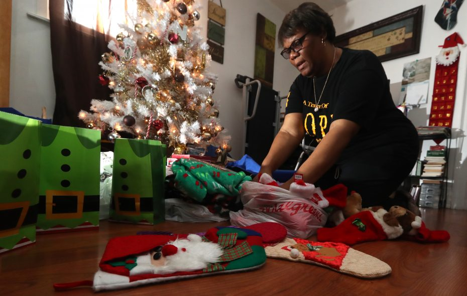 Sharon Tell, at her home in Buffalo, was helped by News Neediest donations in 2004 and now she collects food, clothing and presents for others in need. (John Hickey/Buffalo News)