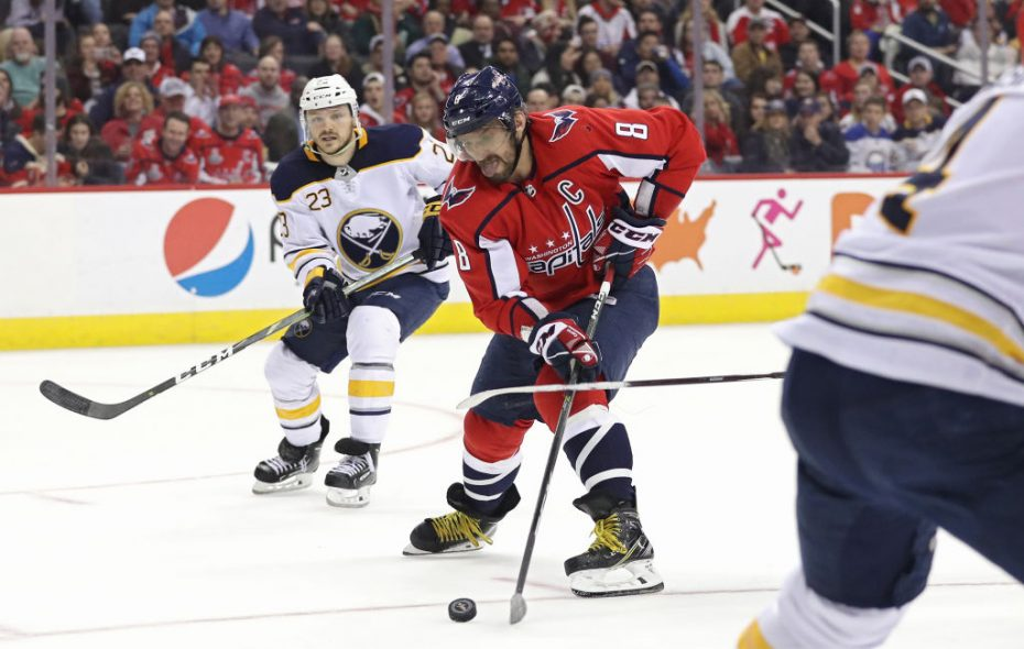 Alex Ovechkin works the puck past Sam Reinhart during the Capitals' 4-3 shootout win over the Sabres Saturday in Washington. (Getty Images)
