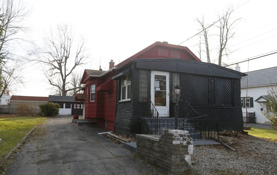 """Neighbors have complained about this """"zombie home"""" at 72 Paige Ave in the Town of Tonawanda. Town officials have reached a settlement with the lenders after suing them this spring. (Mark Mulville/Buffalo News)"""