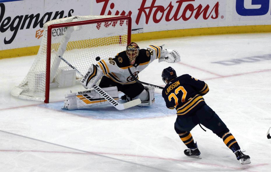 Johan Larsson scores the second Sabres goal on Bruins goalie Tuuka Rask in the second period Saturday in KeyBank Center. (John Hickey/Buffalo News)