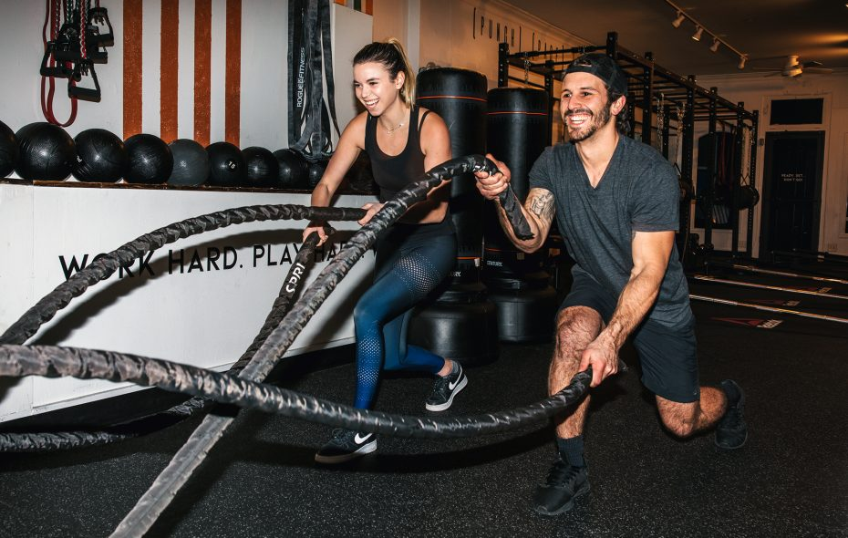 Lex Chambers, a trainer at Sweat Society on Hertel Avenue, and Josh Tornabene do a rotation on the ropes. (Katie Friedman)