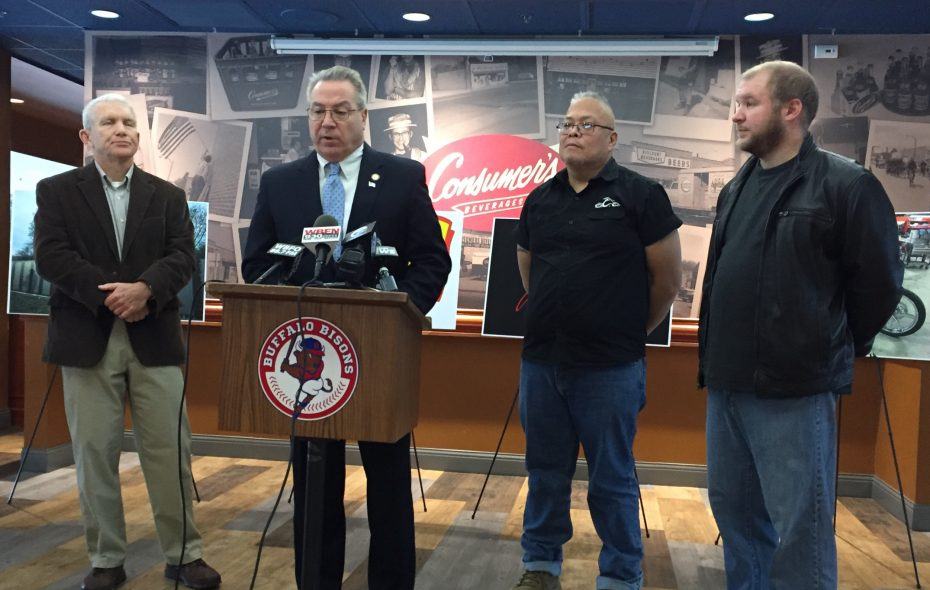 From left, Joe E. Sahlen, president of Sahlen Packing Co., Assemblyman David DiPietro, Santos Lopez of Orange County Choppers and Joe L. Sahlen of Sahlen Packing, announce plans to bring a replica of the Vietnam memorial to Knox Farm State Park. (Barbara O'Brien)